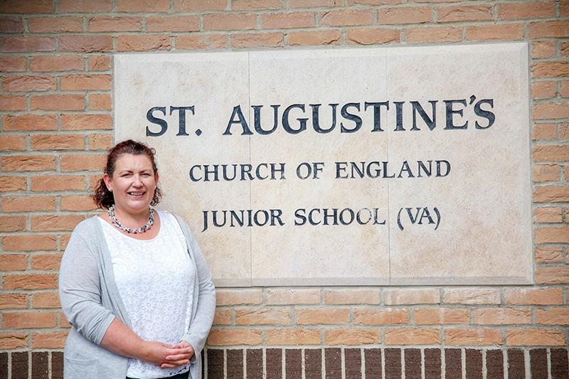 Nicola Pierce - Headteacher standing outside the school